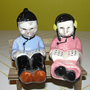 Asian Readers on bench Salt and Pepper Shakers - b51