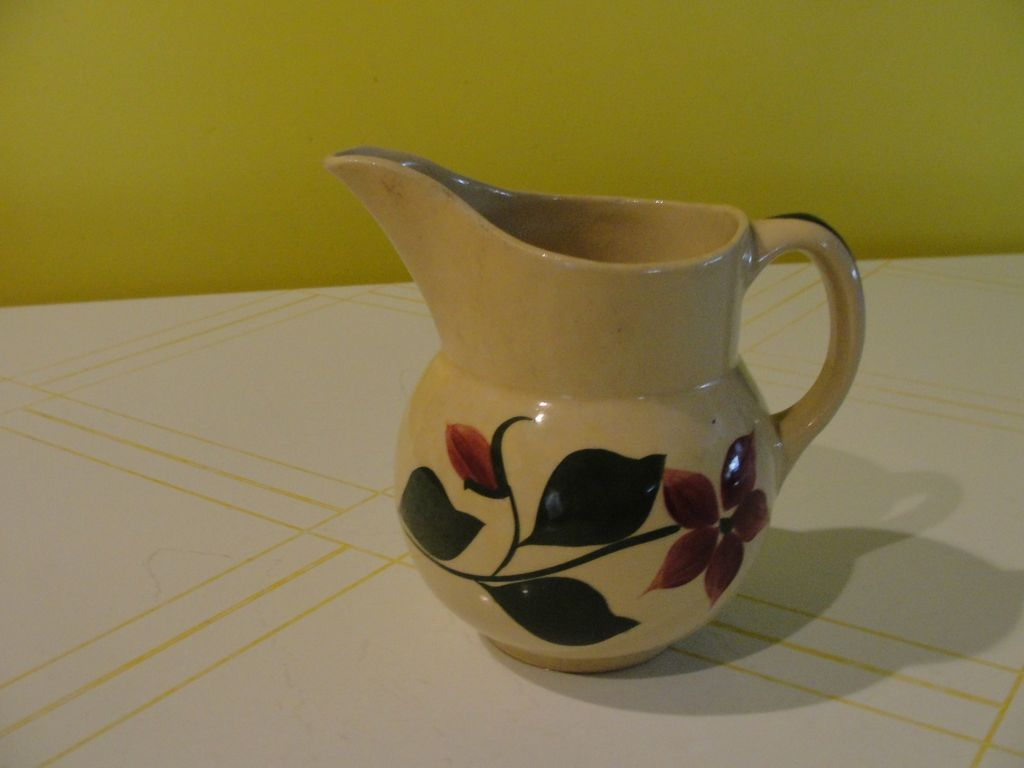 Small Watt Pottery ''Star Flower'' Yellow ware Pitcher
