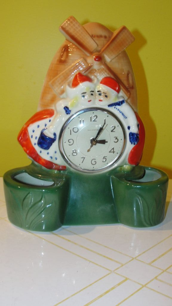 Dutch Couple with Windmill Lanshire Electric Shelf/mantle Clock
