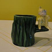 Elf in Yellow on Green Stump