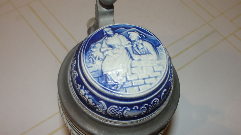 Gerz Salt Glaze Cobalt Cupid and Hunter Stein with Lid