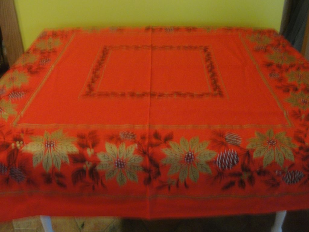 Gold Poinsettias On Red Tablecloth
