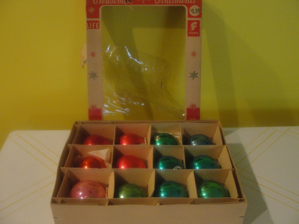 Blue, Green And Red Christmas Tree Ornaments In Box