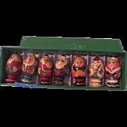 Santas, ladies and snowman in a Row - b183