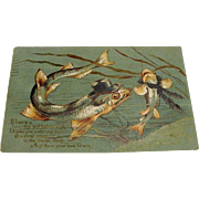 "1906 "" Fishing for a Commitment "" Fish Couple Postcard."