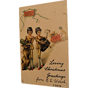 1904: Florence Upton , Tucks Peg Leg Dolls Christmas Postcard