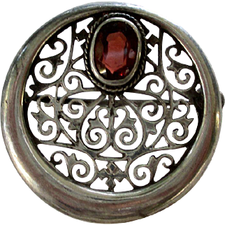 1920s Silver Filigree and Garnet Round Pin