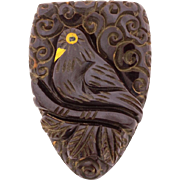 "Carved Black Bakelite Dress Clip, Black Bird with Yellow Painted Beak & Details, 2"" high"