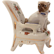 Antique Porcelain Pug Dog with Dresden Bell Collar in Flowered Chair Miniature Figurine
