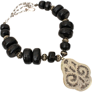 """Ethnic Black Bead Necklace with Large Engraved Silver Tone Pendant, 28"""" Adjustable Length"""