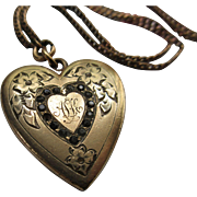 Older Vintage Heart locket in Gold Fill Paste Stones and Floral Chasings