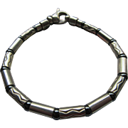 Tiffany and Co. Sterling Hemitite Chased Link Bracelet Aztec Design