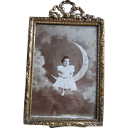 Early 1900s Framed Photo Child Sitting on Crescent Moon