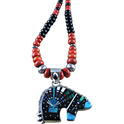 White Fox Creation: Two Necklaces In One: Navajo Ray Jack Pendent with South China Sea Coral and Onyx Necklace