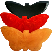 Three Bakelite Butterfly Pins Solid Black Marbled Red and Marbled Butterscotch