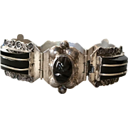 Del Rio Sterling Mexico Black Onyx Carved Face and Sterling Trimmed Domed Cabs Bracelet