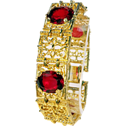 Big Bold Goldtone Panel Bracelet with Red Glass Stones