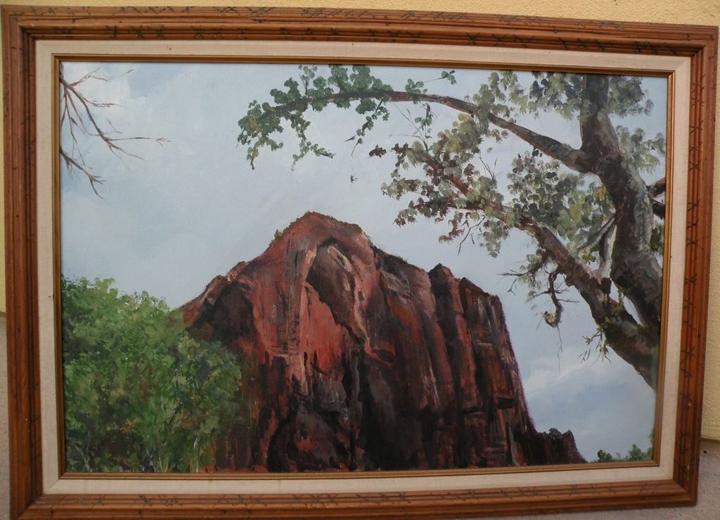 Decorative signed landscape painting of red rocks and tree