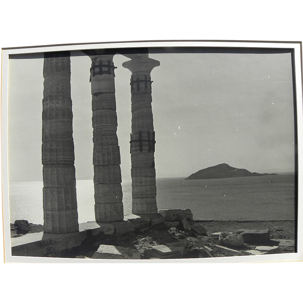 Old photograph of ancient Greek temple by the sea