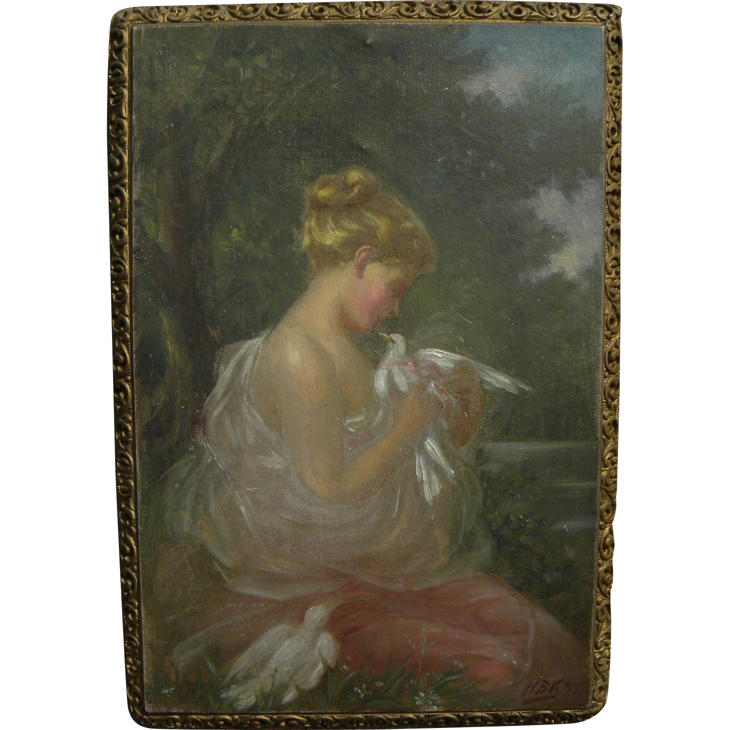 Impressionist painting of a young woman with doves in a landscape signed with initials and dated 1897