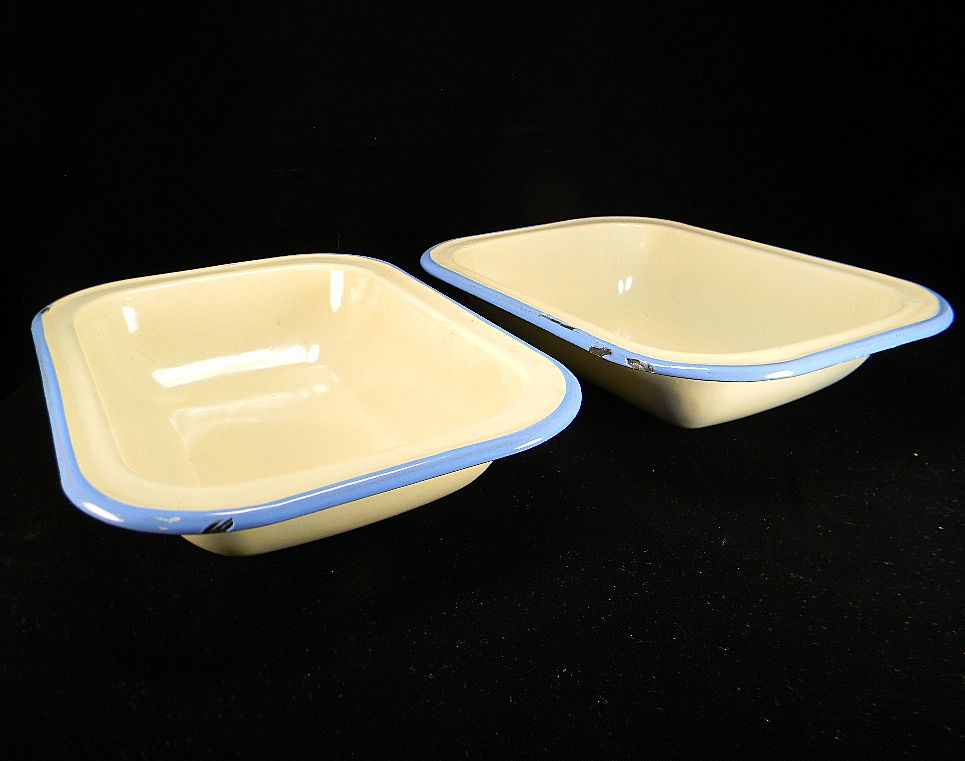 Two Cream-Colored Enamel Bowls with Light Blue Trim
