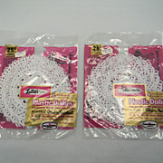 Two Sets of Four White Lustro-Ware Doilies in Original Packaging