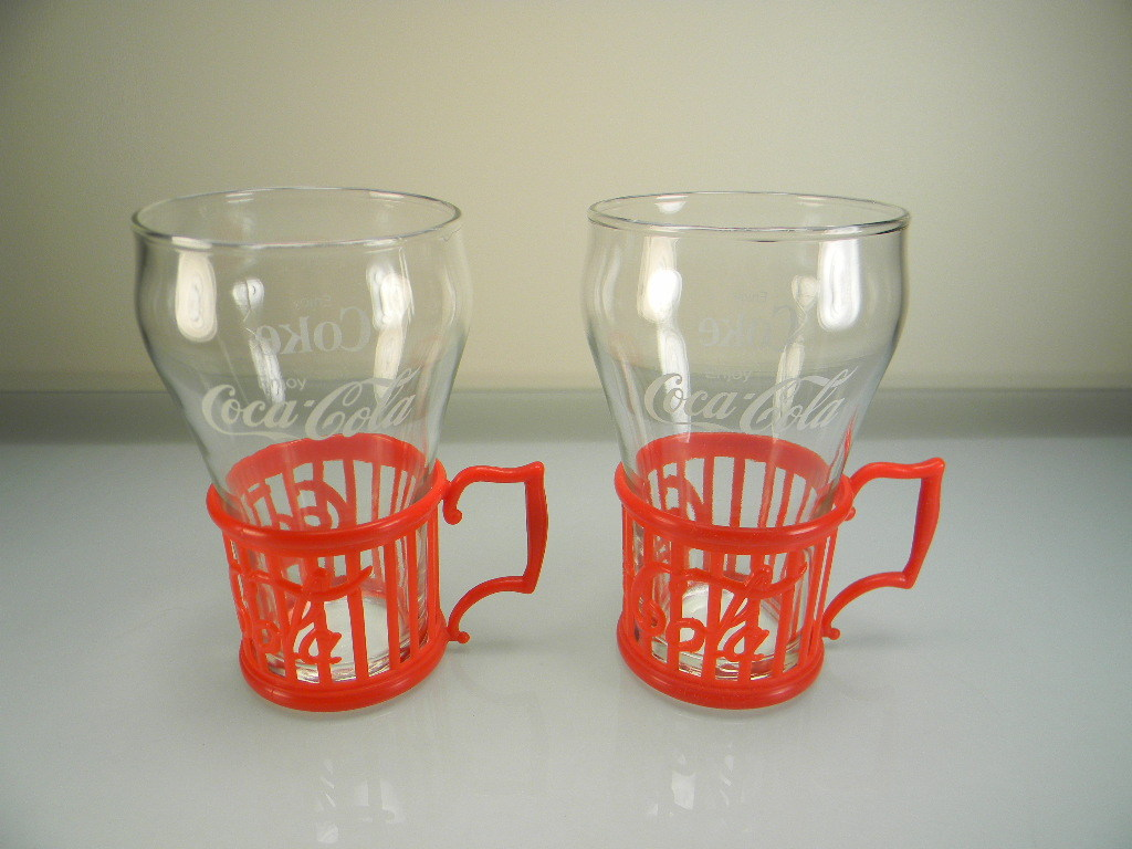 Two Vintage Coca-Cola Tumblers with Red Plastic Coca-Cola Holders