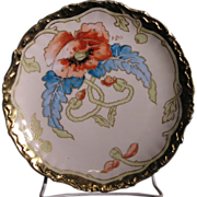 Hand painted Elite Limoges porcelain plate decorated with a large orange poppy