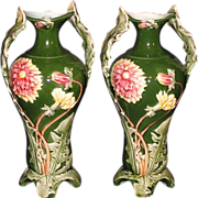 French Art Nouveau majolica pottery vases with dandelion leaf handles and decorations