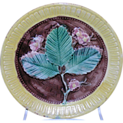 Majolica three leaf strawberry flower decorated plate with brown basket weave and yellow outer rim