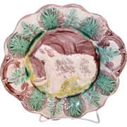 Wonderful old large Majolica pottery plate with the central design of a dog and his dog house