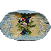 Beautiful American Majolica tray has a raised fruit grouping as its center design on a Turquoise and yellow ground