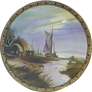 Hand Painted Nippon wall plate with a Floral and leaf border, thatched house and boat scene. - Red Tag Sale Item