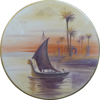 Hand painted Nippon trivet, painted with sailing barge and palm trees in matt finish, Gold around outside rim