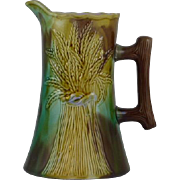 Beautiful Victoria Majolica Pitcher with sheaves of wheat and a Bark handle