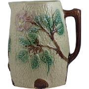 Antique tree bark majolica pitcher with pink wild roses and a Twig branch handle