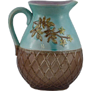 Victorian Floral and basket weave majolica pitcher