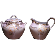 R.S. Germany covered sugar and creamer with yellow rose floral decorations