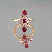 Magical 18K Gold Star Ring with Diamonds, Rubies, and a Garnet