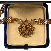 Antique Victorian Mesh Necklace with an Ornate Garnet-Studded Medallion, Rosy Gold Fill