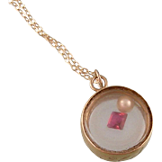 """Big Old Doll"" 14K Gold and Glass Antique Locket Pendant with Garnet and Pearl Enclosed"