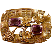 Showy Art Nouveau Sash Pin with Two Amethyst Glass Stones, a Butterfly, an Iris, and Grapes