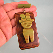 Very Large Bakelite-on-Wood Dangling Pin, Tribal Figure