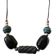 "Kazuri bead Necklace: Kenya Africa: handcrafted and original: silver filigree rounds: black and moss green,  27"" necklace."