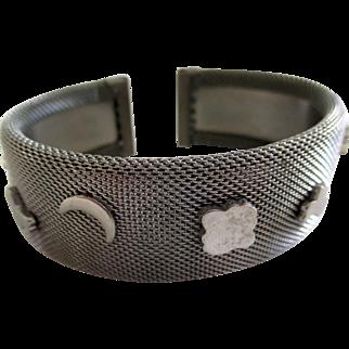 Silver tone mesh cuff bracelet.  Nine charms, vintage 60s-70s.
