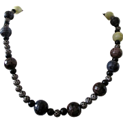 "Necklace; 18"" bead necklace in blue, brown, gray, black, dark purple, and creamy white: fancy toggle: handcrafted: Artisan"