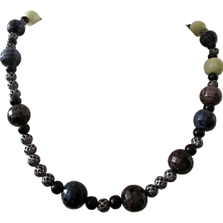 "Color and Texture are this necklace, Artisan 18"" bead necklace in blue, brown, gray, black, dark purple, and creamy white.  Closed with a fancy toggle"