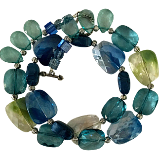 Artisan necklace: blues, greens, white clear lucite beads, silver spacers, toggle, 25""