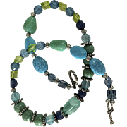 "PNE SALE:  Artisan: necklace:  Lucite 20"" surf and beach necklace: Blues, Greens, Aqua beads: Silver spacers: Antique toggle clasp"