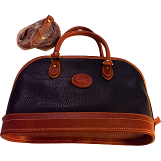 Dooney Bourke vintage all weather leather Purse: pebbled leather: Navy and British Tan